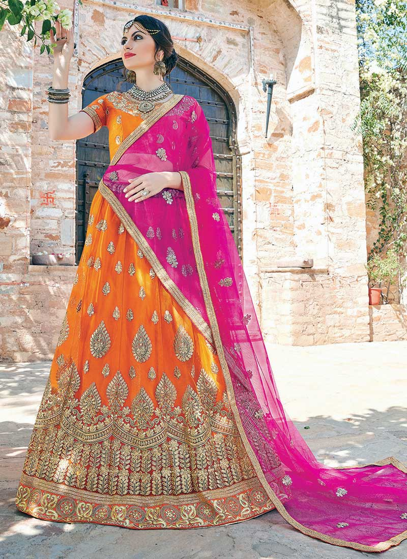 Beckoning Orange Net Embroidery Work Lehenga Choli