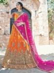 Beckoning Orange Net Embroidery Work Lehenga Choli
